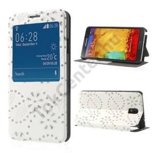 Samsung Galaxy Note 3. (SM-N9000) Tok álló, bőr (FLIP, oldalra nyíló, asztali tartó funkció, hívószámkijelzés, S-View Cover, virágmintás, strasszkő) FEHÉR