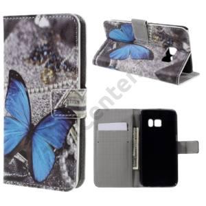 Samsung Galaxy S7 (SM-G930) Tok álló, bőr (FLIP, oldalra nyíló,  asztali tartó funkció, kék pillangóminta) SZÜRKE
